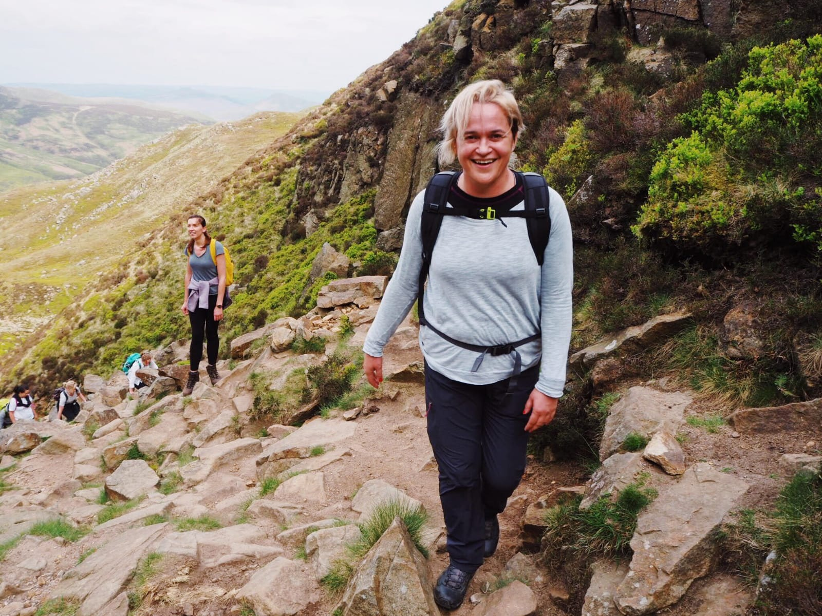 Image of Cath smiling in the hills